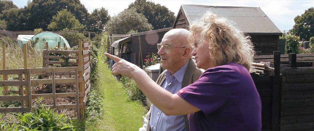 One of the Sherwood House care team with resident in the allotment area